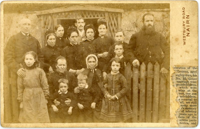 19th century photograph of large family gathered in from of house